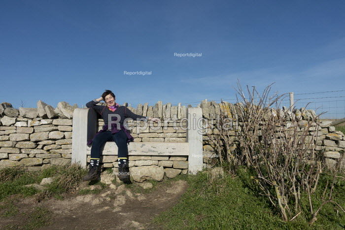 Walker resting after a steep climb, The Isle of Purbeck peninsula, Dorset - John Harris - 2019-02-14