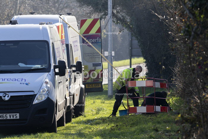BT workers installing Openreach broadband cables, Highworth, Wiltshire - John Harris - 2019-02-25