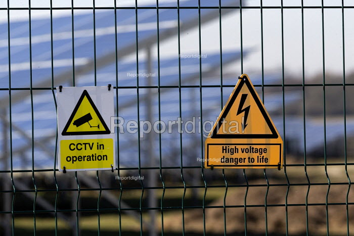 Solar panel farm, Cotswolds. CCTV in operation, High voltage danger to life signs - John Harris - 2019-02-25