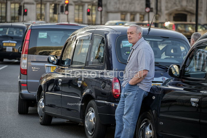 Striking Licensed taxi drivers blocking Pariament Square and Whitehall London. Strike in protest at a TFL proposals to ban black cabs from central London bus lanes - Philip Wolmuth - 2019-02-27