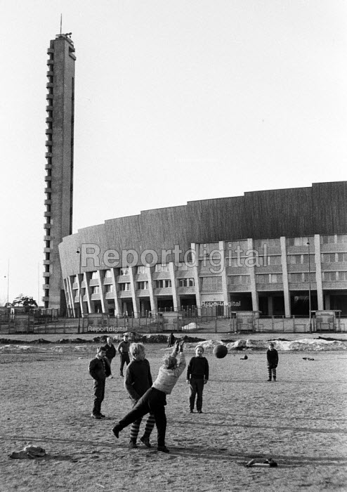 Finland 1963 Newly housing blocks designed by architect Aarne Ervi and built in the post war reconstruction plan. Boys playing football using jumpers for goal posts - Romano Cagnoni - 1963-05-11