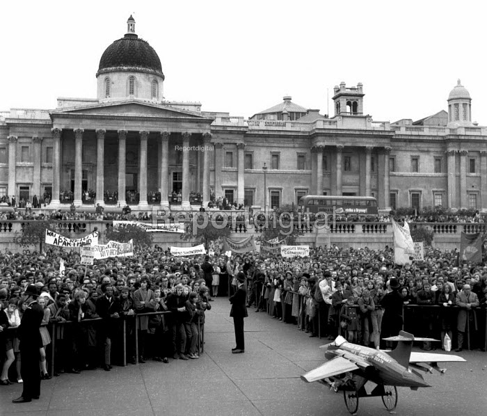 Anti Apartheid rally Trafalgar Square London 1970. A model of a Hawker Siddeley Buccaneer S.50 used by the South African air force: Mechants of Death - Chris Davies - 1970-10-25