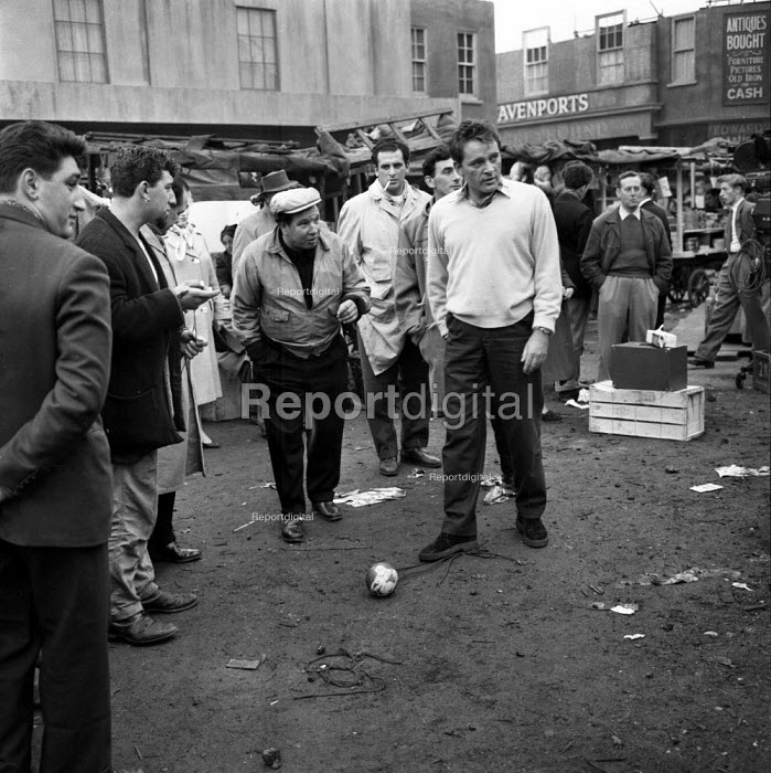 Richard Burton playing football on film set of Look Back in Anger, 1959 Producer Harry Saltzman (L) a street market in Romford - Romano Cagnoni - 1959-03-28