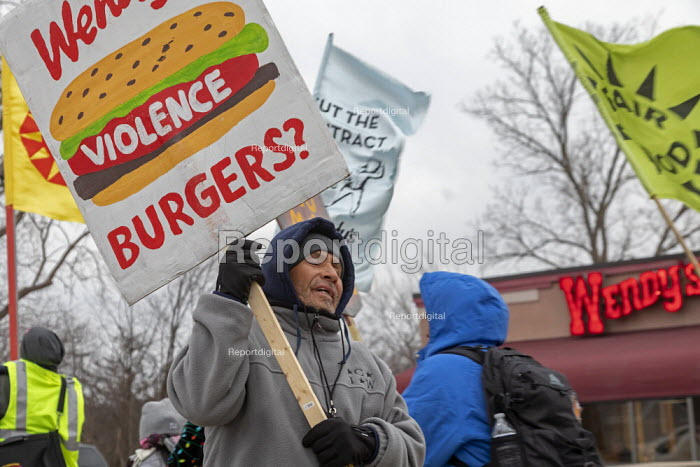 Ypsilanti, Michigan USA: Coalition of Immokalee Workers protest at a Wendy's fast food restaurant, asking the company to pay more for the Florida tomatoes to improve wages for Florida farmworkers, who are subject to sexual violence at work. The rally was part of a tour of Wendy's stores in several university towns. CIW wants the universities to boycot Wendy's until the chain joins the Fair Food Program - Jim West - 2019-03-09