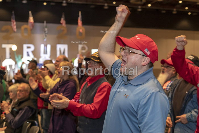 Detroit, Michigan, USA: We Build the Wall Rally to promote construction of a Mexican border wall. Enthusiastic audience with Make America Great Again and Donald Trump baseball caps - Jim West - 2019-03-14