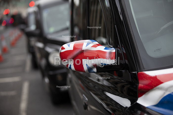 Black cab drivers blocking roads in a dispute with Transport for London, Westminster, London. TFL want to ban taxis from using certain roads and from using a bus lane near London Bridge. The drivers want to be able to drive in bus lanes - Jess Hurd - 2019-03-20
