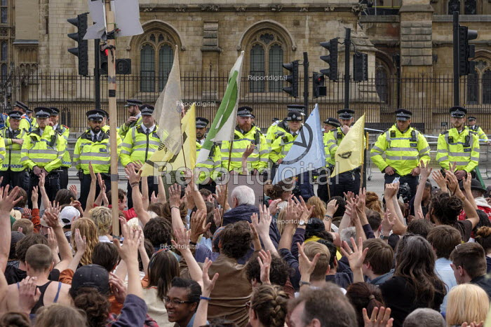 Police officers cordoning off the Houses of Parliament from Extinction Rebellion climate change protest, Parliament Square, London - Philip Wolmuth - 2019-04-23