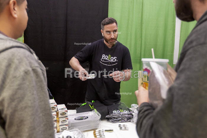 "Mt. Pleasant, Michigan, USA, 420 Canna Expo, ""Rollos"" rolling papers. Canna Expo is a trade show for companies selling goods and services for the medical and recreational marijuana industry. Michigan legalized recreational marijuana in 2018. - Jim West - 2019-04-20"