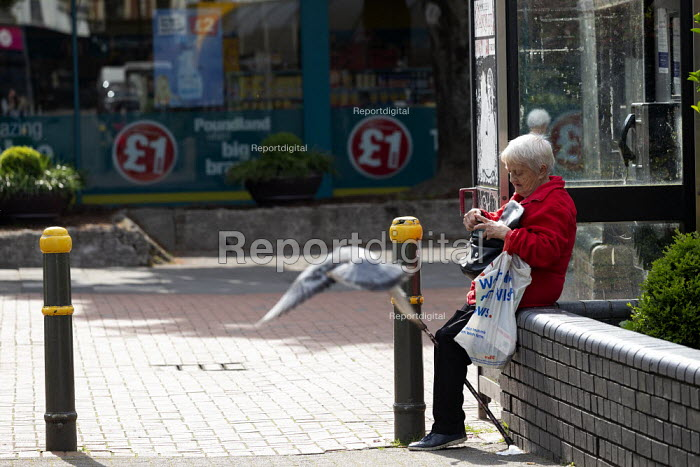 Pensioner checking her purse, High Street, Merthyr Tydfil, South Wales - John Harris - 2019-05-15