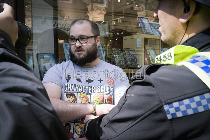 Police arresting Paul Crowther for throwing a milkshake at Nigel Farage, Newcastle Upon Tyne, Brexit Party European parliament elections campaign - Mark Pinder - 2019-05-20