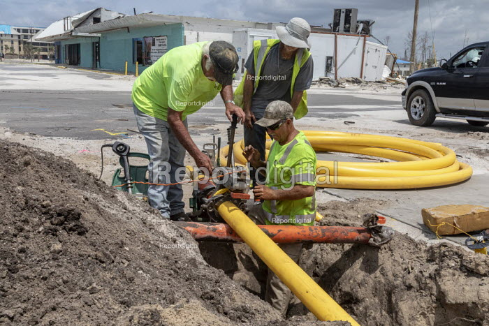 Mexico Beach, Florida, USA: Workers replacing a gas pipe 7 months after the town was devastated by Hurricane Michael - Jim West - 2019-05-09