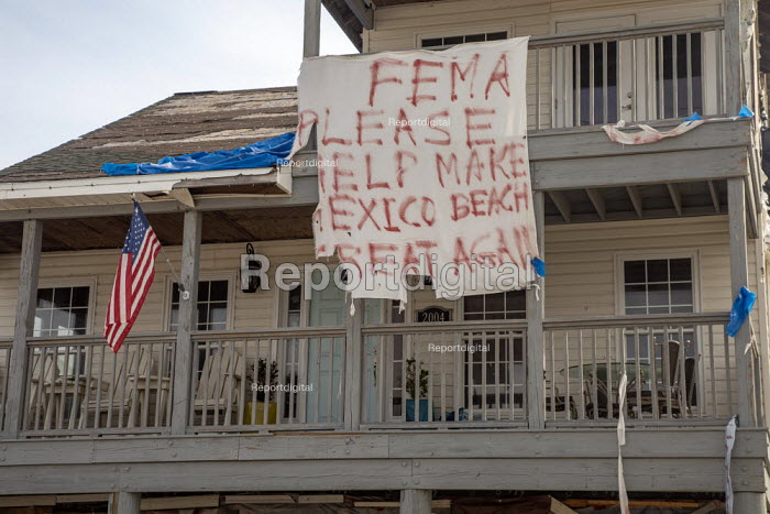 Mexico Beach, Florida, USA: A plea for help from the Federal Emergency Management Agency hanging on a damaged home. Destruction from Hurricane Michael 7 months after the storm hit the Florida Panhandle - Jim West - 2019-05-10