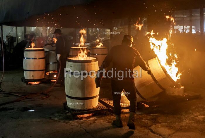 Louisville, Kentucky, USA: Workers at Kelvin Cooperage making oak barrels for aging bourbon and wine. Barrels are charred to add flavor during the aging process. - Jim West - 2019-05-20