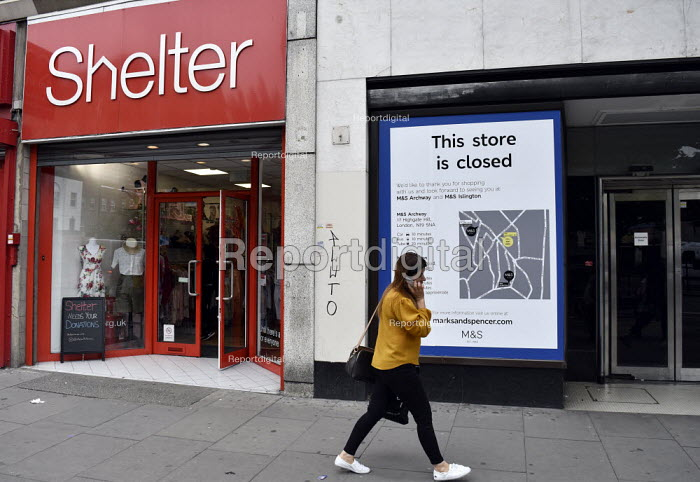 High Street store closures. Marks and Spencers store on Holloway Road north London closed whilst neighbouring Charity shop Shelter remains open.High Street store closures. Marks and Spencers store on Holloway Road north London closed whilst neighbouring Charity shop Shelter remains open.High Street store closures. Marks and Spencers store on Holloway Road north London closed whilst neighbouring Charity shop Shelter remains open.High Street store closures. Marks and Spencers store on Holloway Road north London closed whilst neighbouring Charity shop Shelter remains open. - Stefano Cagnoni - 2019-06-19