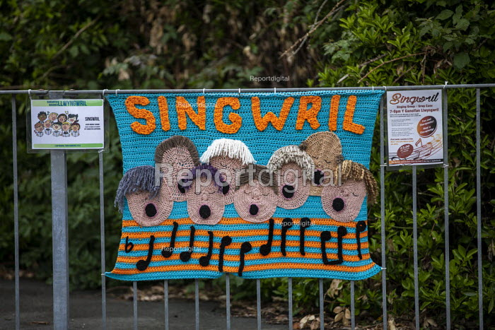 Singwril, singing group, Yarn bombing or guerrilla knitting in Llwyngwril, the quirky little Welsh village knits creations through the winter as a community project to decorate the village in the summer months, Cambrian Coast, Snowdonia National Park. - Jess Hurd - 2019-06-25