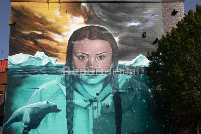 Greta Thunberg mural Bristol, painted by Jody Thomas a Bristol Graffiti artist. It depicts Swedish climate change activist Greta Thunberg being submerged in water as global warming melts the icecaps raising sea levels with a polar bear swimming past - Paul Box - 2019-06-28