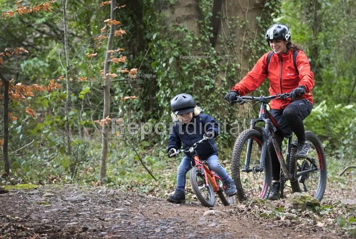3 year old boy and mother riding mountain bikes, Ashton court, Bristol - Paul Box - 2017-05-03