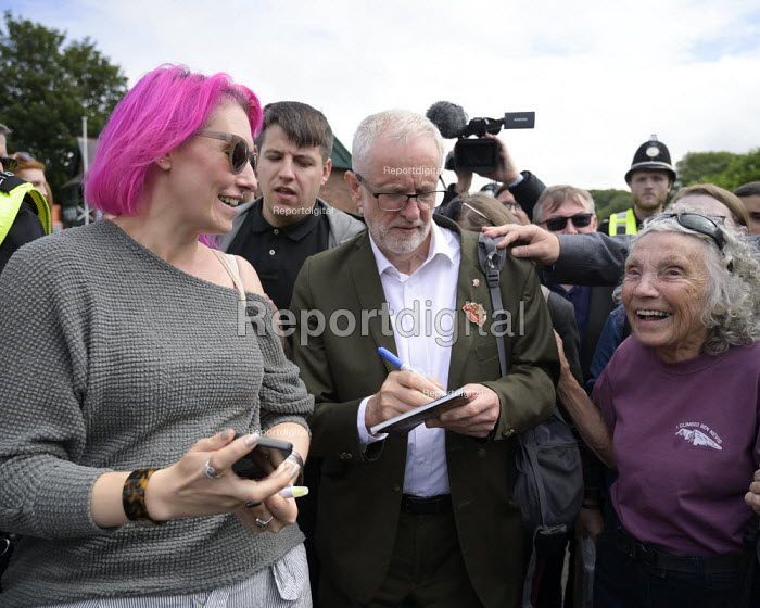 Jeremy Corbyn signing an autograph for a supporter, 2019 Durham Miners Gala - Mark Pinder - 2019-07-13