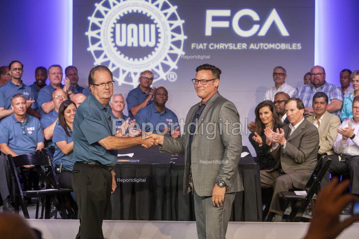 Michigan, USA: Fiat Chrysler and the UAW opening negotiations for the 2019 collective bargaining contract. UAW Pres. Gary Jones (L) shaking hands with FCA Chief Operating Officer Mark Stewart - Jim West - 2019-07-16