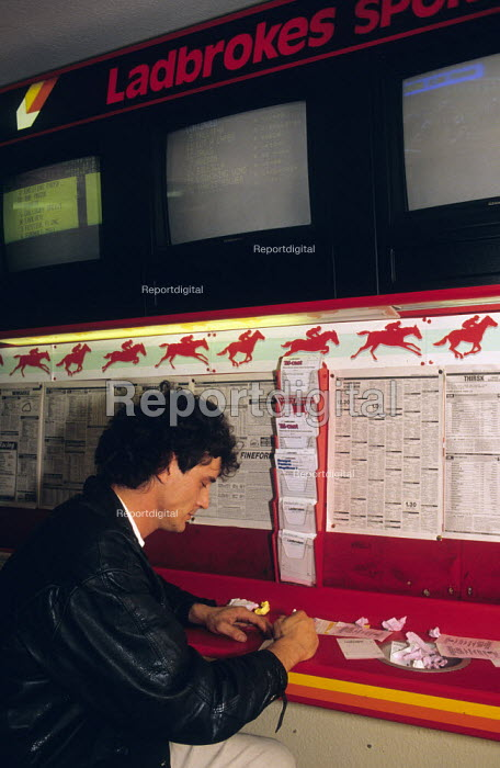 Man placing bet, Ladbrokes betting shop 1989 - John Harris - 1989-11-11