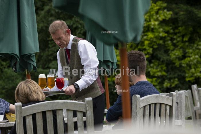 Waiter serving drinks, Lords Of The Manor Hotel, Upper Slaughter - John Harris - 2019-07-20