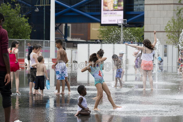 Heatwave. Children playing with water jets, Centenary Square, Birmingham, reflection pool with fountains - John Harris - 2019-07-25