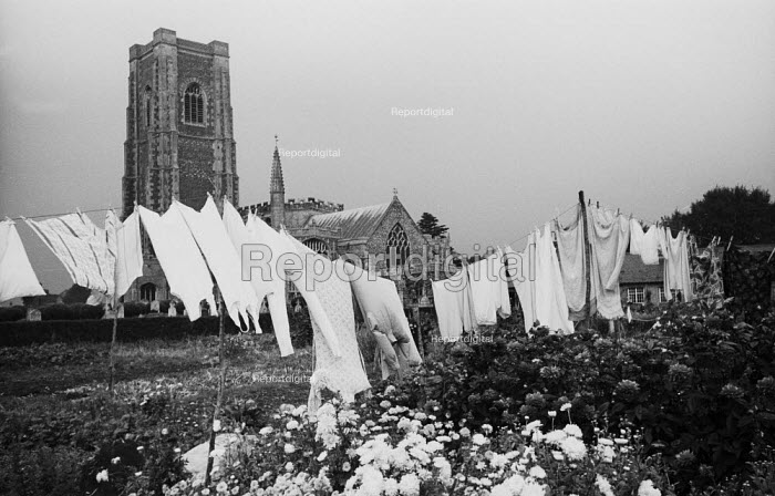 Washing drying on the clothes line by the Parish Church of St Peter and St Paul in the mediaeval village of Lavenham Suffolk 1958 - Kurt Hutton - 1958-10-20