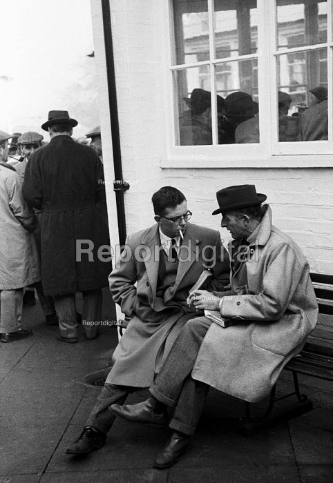 Tattersalls Newmarket Stables Cambridgeshire 1958, buyers in conversation at the annual bloodstock auction sales for racehorses - Kurt Hutton - 1958-12-03