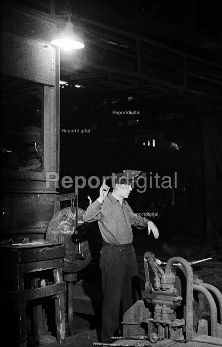 Jim McCubbin, plate mill Dalzell Steel Works Motherwell 1958. Using a system of hand signals to communicate above the noise to govern the setting of the rolls in the steel mill - Kurt Hutton - 1958-02-15