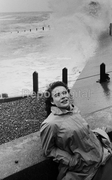 Young woman at seafront during storm Aldeburgh 1958 - Kurt Hutton - 1958-03-05