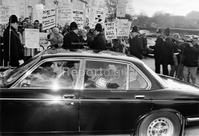 Margaret Thatcher and Dennis are driven past an anti cuts protest, town hall, Maidstone, Kent, 1984 - NLA - 1984-01-06