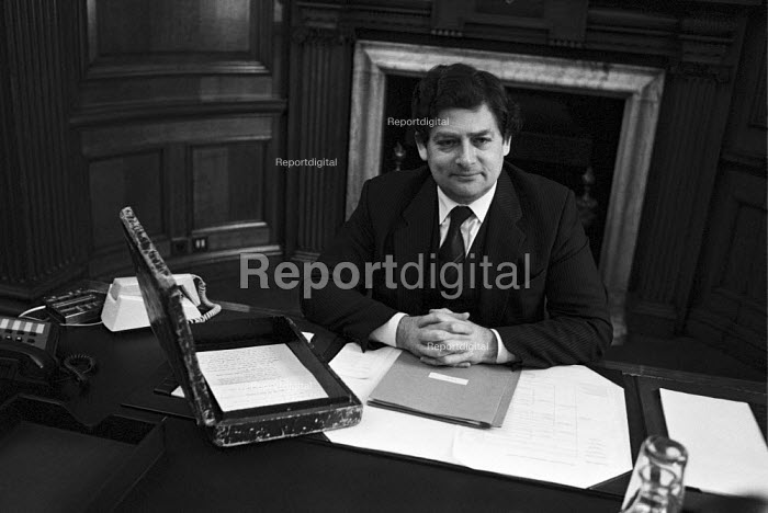 Nigel Lawson, Chancellor of the Exchequer 1983 in his office with the red box box before the budget - NLA - 1984-03-06