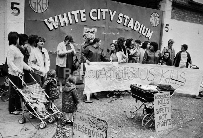 White City estate residents protest at the dangers of asbestos from the demolition of White City Stadium, West London. Aspestos Kills banner, Safety not Profits - NLA - 1984-10-16