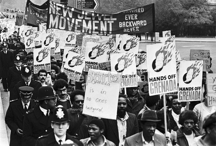 Protest against the US invasion of Grenada, London 1983. New Jewel Movement banner - Peter Arkell - 1983-11-05