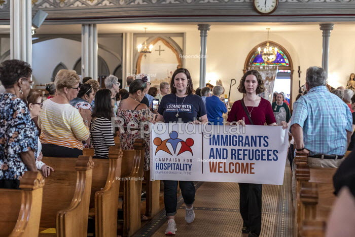 Detroit, Michigan, USA: Catholic mass for immigrant families that are separated or in detention. The event raised money for the Catholic Dioceses of El Paso and Brownsville for their work among immigrant families. Holy Trinity Catholic Church - Jim West - 2019-07-30