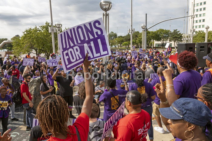 Detroit, Michigan USA: SEIU Security guards rally at the Labor Legacy Monument for union recognition at downtown buildings owned by businessman Dan Gilbert - Jim West - 2019-07-31