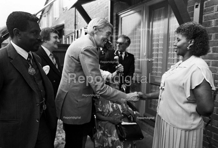 Lord Scarman opening a new council housing estate, Brixton, South London, 1984 and meeting one of the tenants. Ted Knight, leader of the local Lambeth Council, is in the background (L) - NLA - 1984-06-15