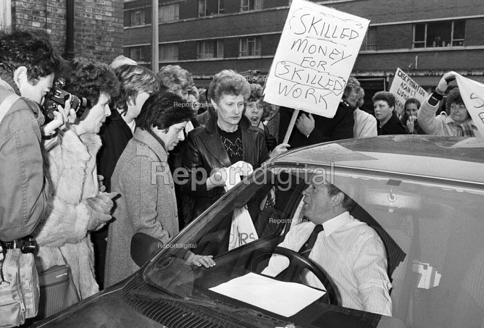 Ford sewing machinists lobby the TGWU for action in support of equal pay 1984 Ron Todd as he leaves after talks with Ford management in London over their claim for equal pay and a pay rise. - Peter Arkell - 1984-11-15