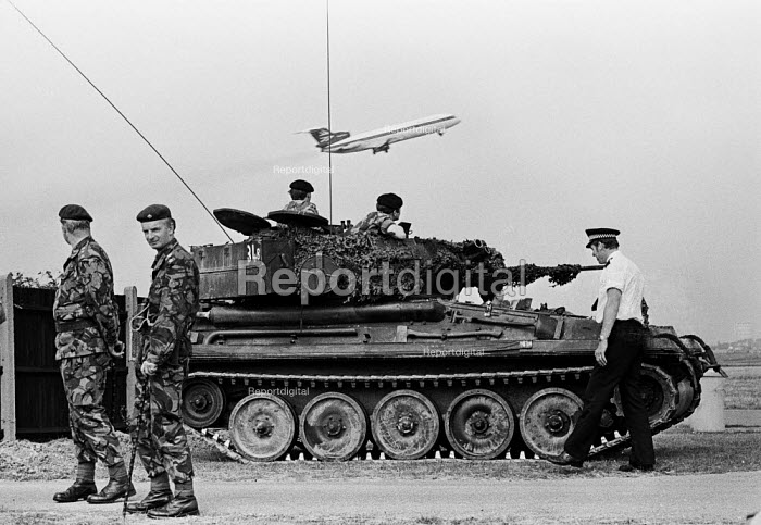 Troops, including tanks and armoured cars, occupy London's Heathrow Airport in response to security threats, including from the IRA--one of several such occupations in the 1970s and beyond. - NLA - 1978-07-17