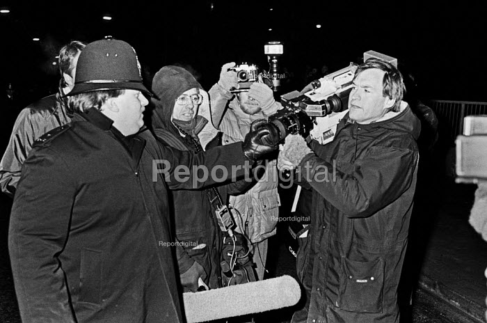 Policeman stopping a TV cameraman from filming, picket line, Wapping dispute, East London, 1986 - Peter Arkell - 1986-02-28