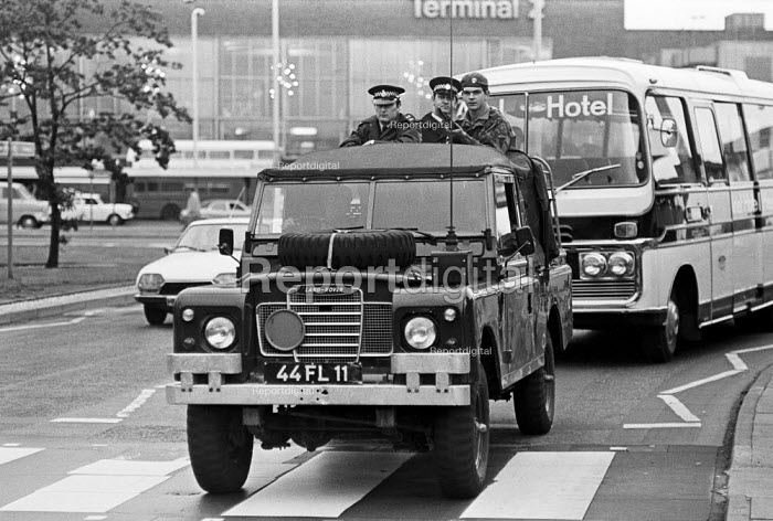 Troops, including tanks and armoured cars, occupy London's Heathrow Airport in response to security threats, including from the IRA--one of several such occupations in the 1970s and beyond. - Peter Arkell - 1974-06-26