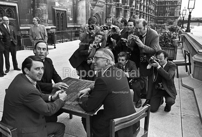 Christopher Mayhew defecting from Labour to the Liberal Party (R) 1974, with David Steele (L), Jeremy Thorpe infront of press photographers, House of Commons, London - Peter Arkell - 1974-07-10
