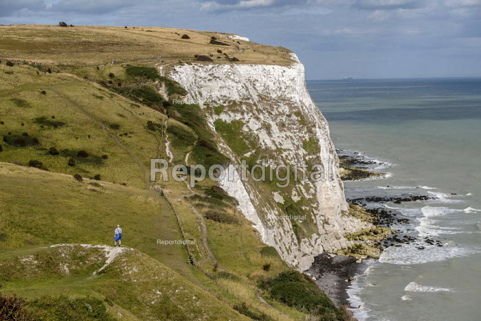 Hiker on the south-eastern coastal path as it crosses the White Cliffs of Dover, Kent. - Philip Wolmuth - 2019-08-15