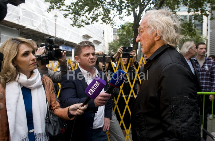 Journalist John Pilger being interviewed by Russian news tv crews, Protest against threatened extradition of imprisoned WikiLeaks journalist Julian Assange, Home Office, London - Stefano Cagnoni - 2019-09-02