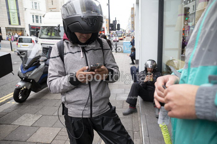 Uber Eats and Deliveroo riders waiting for work, Brighton - John Harris - 2019-09-09