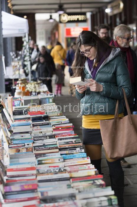 Customer browsing The Harbourside Books stall, Harbourside Market, Bristol - Paul Box - 2016-03-19