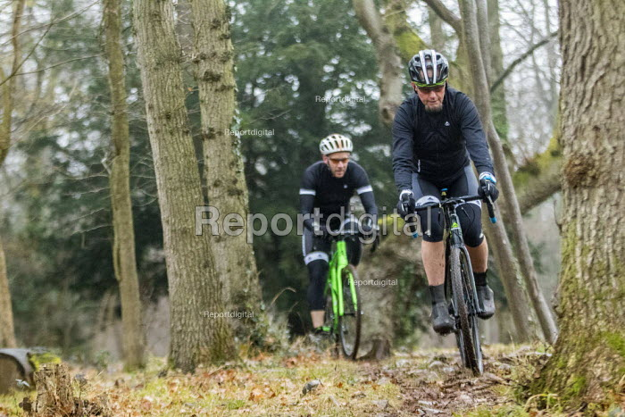 Cyclo-cross riders in the woods, Bristol. Cyclo-cross is a form of off-road cycle racing - Paul Box - 2018-01-20