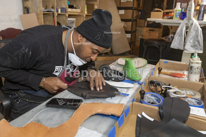 Detroit, Michigan, USA: An Air Force veteran making footwear, Pingree Detroit. Pingree is a worker owned company that hires veterans to make footwear and other products with leather reclaimed from the auto industry. - Jim West - 2019-10-15