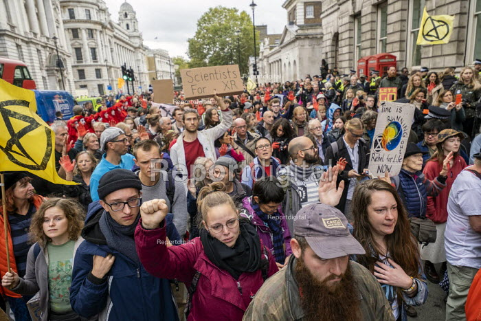 Scientists for XR, Extinction Rebellion red hand, last day protesting against lack of Government action on climate change. Nonviolent direct action shutting down central London. - Jess Hurd - 2019-10-18