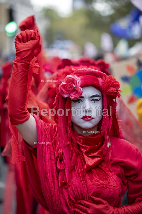 The Invisible Circus, Extinction Rebellion activists dressed in red robes and with white makeup. Extinction Rebellion red hand, last day protesting against lack of Government action on climate change. Downing Street, London. - Jess Hurd - 2019-10-18